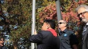kerry jang raising flag at Vancouver City Hall