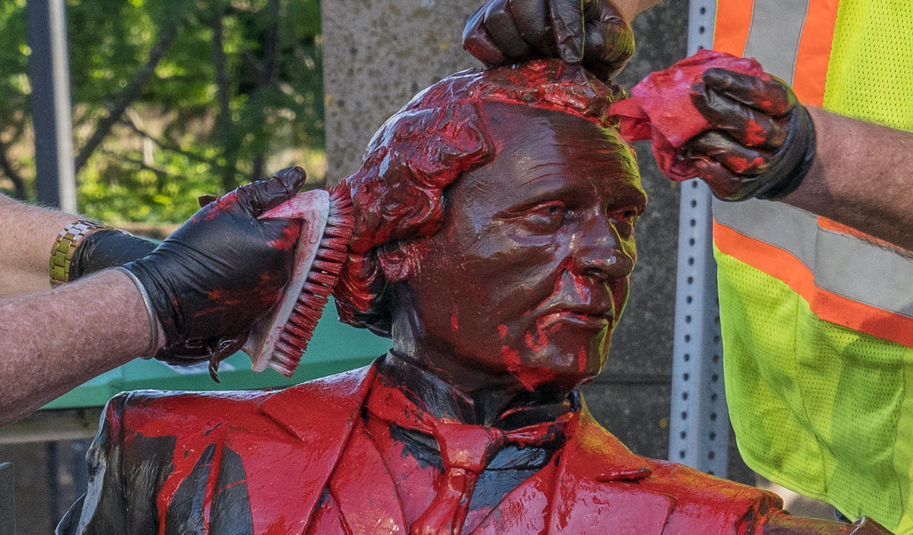 Workers clean the vandalized Charlottetown John A. statue
